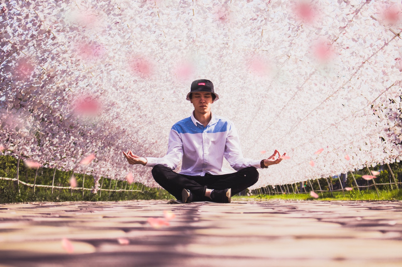 man-meditating-in-the-middle-of-pathway-1525852